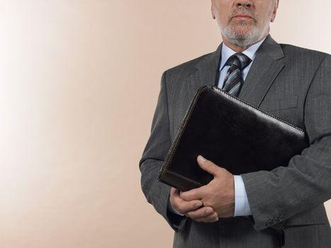 Businessman Holding Leather Binder