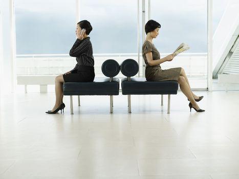 Businesswomen Sitting on Bench