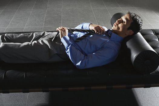 Businessman Lying on Sofa