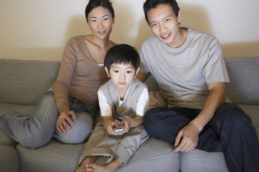 Couple Watching Television with Son