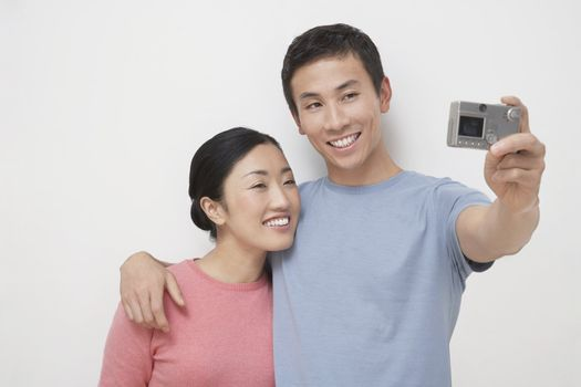 Couple Taking Photograph of Themselves
