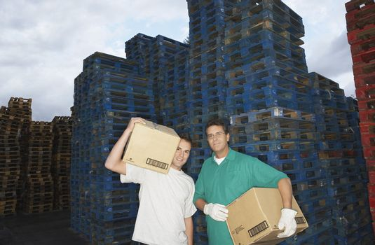 Warehouse Workers Carrying Boxes