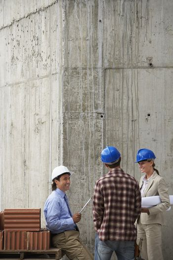 People Talking at Construction Site