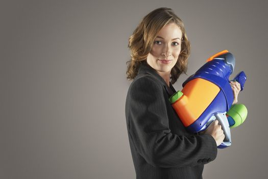 Businesswoman Holding Water Gun