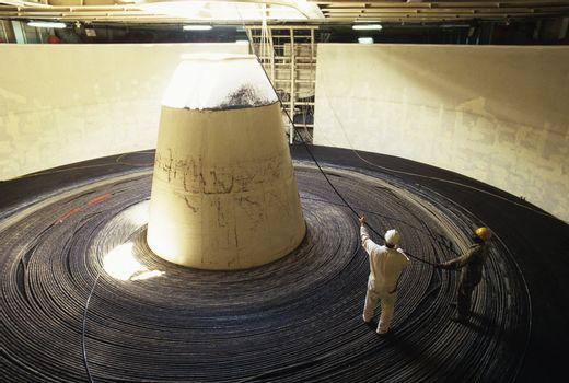 Workers Standing on a Giant Coil of Cable