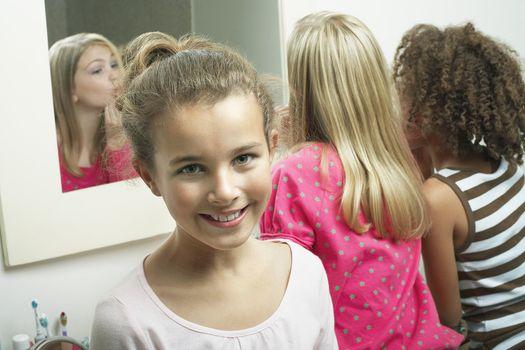 Girls Trying on Cosmetics