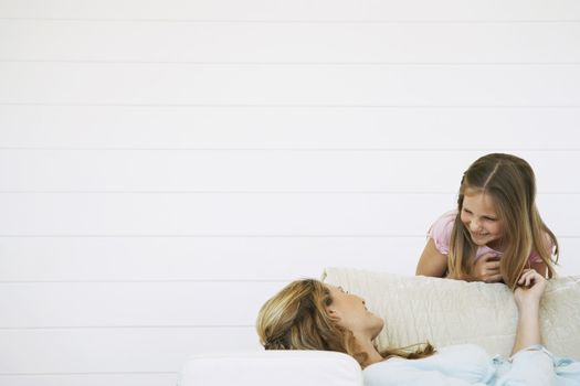 Woman With Daughter on Sofa