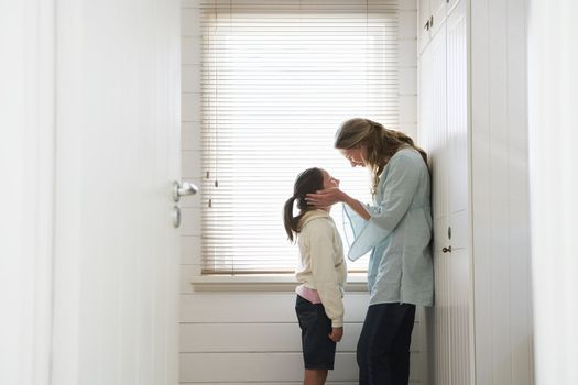 Woman and Daughter By Window