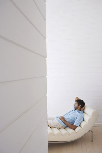 Man Relaxing on Chaise Longue