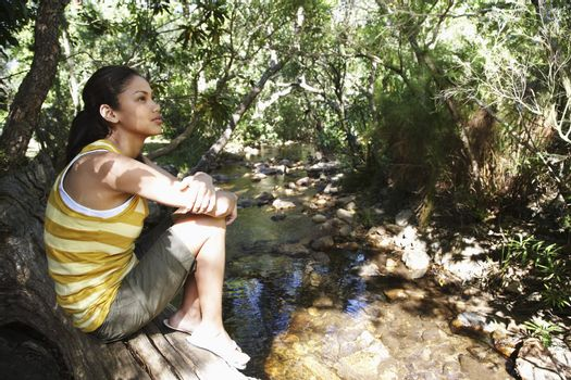 Young Woman Standing by Creek