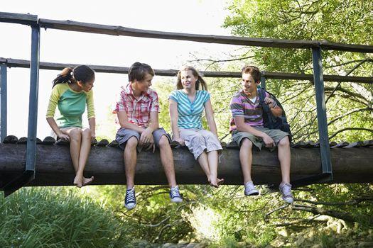 Teens Sitting on Bridge