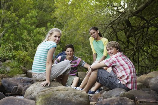 Young Friends Sitting on Rocks