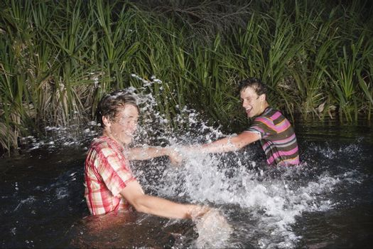 Young Man Splashing Each Other