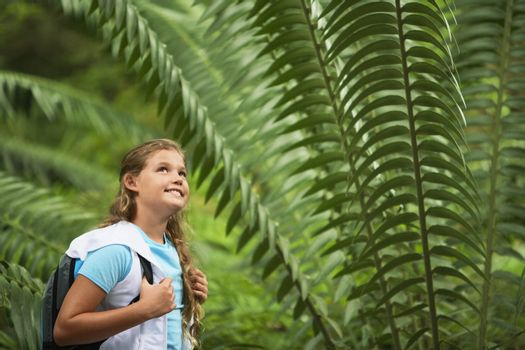 Girl Standing by Large Fern