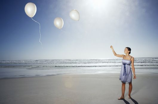 Woman With Balloons on the Beach