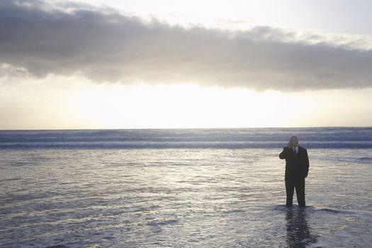 Businessman Standing in the Ocean