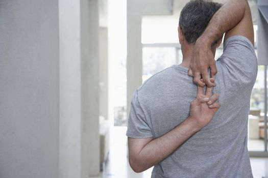 Man Stretching His Shoulders