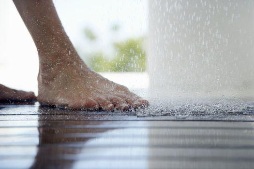 Foot Under Dripping Water