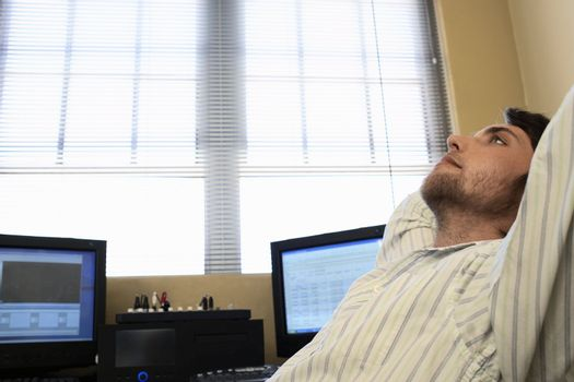 Man Relaxing by Computer