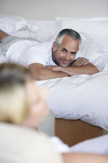 Man Laying in Bed