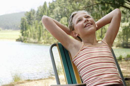 Girl Relaxing by Lake