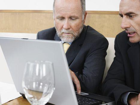 Businessmen on Laptop