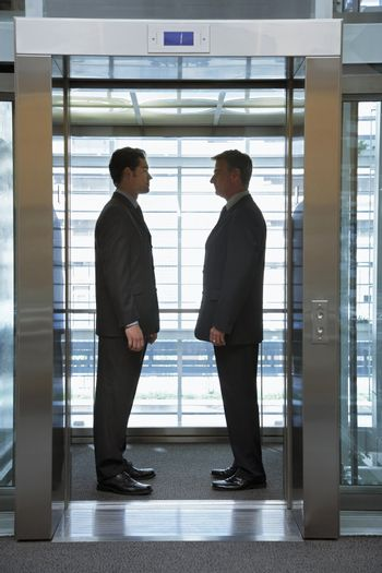 Businessmen Standing Face to Face