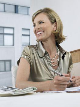Businesswoman Holding Pen