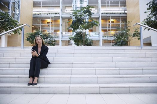 Businesswoman Thinking on Stairs