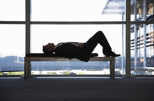 Businessman Napping on Bench