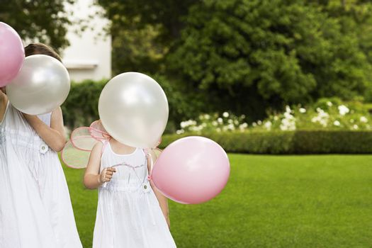 Girls with Party Balloons