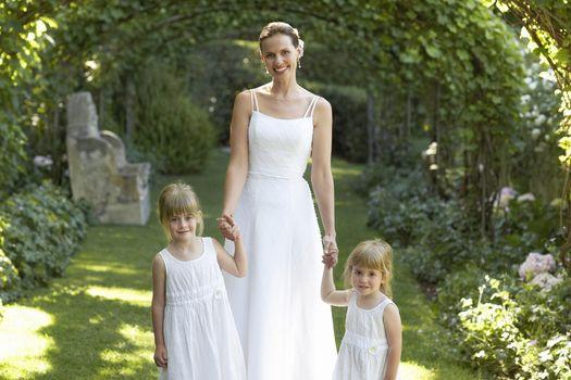 Bride and Flower Girls in Formal Garden