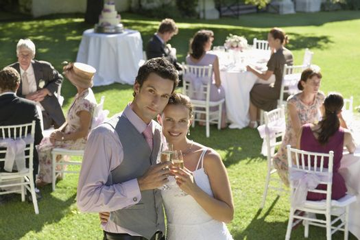 Bride and Groom Toasting at Reception