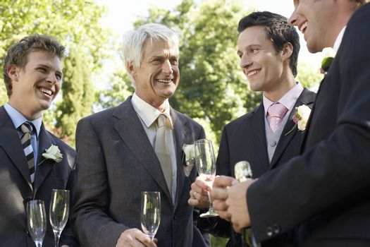Groom with Groomsmen and Father