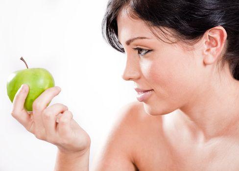 Beautiful woman holding a apple,indoor studio