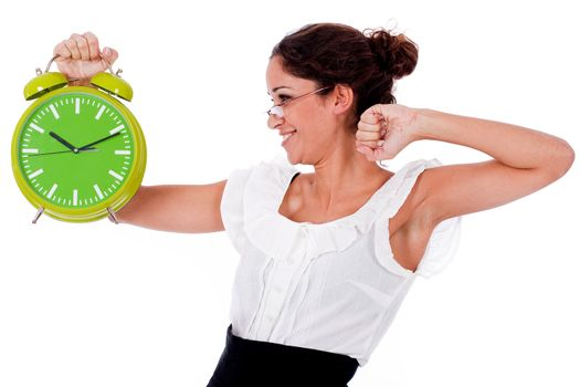 Shot of a Young business woman holding clock on isolated white background