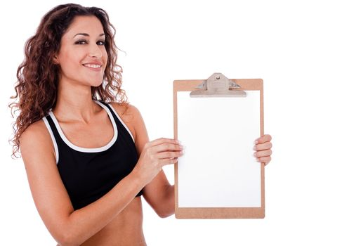 Fitness woman showing a blank clip board on a isolated white background