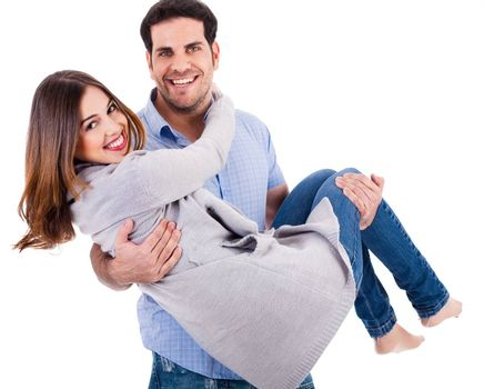 Cheerful young couple piggybacking on a white background