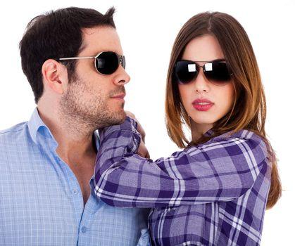 Stylish man and women wearing sunglasses indoor studio