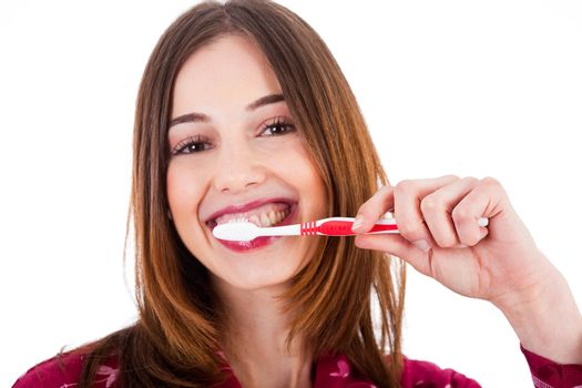 Women brushing her teeth on a white background