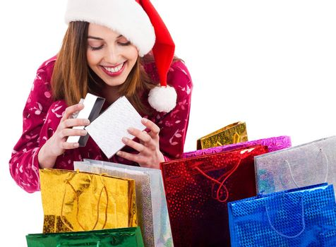 Santa girl opening the gift box on a white background