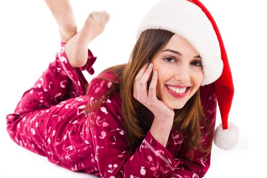 Santa girl relaxing by lying down and smiling on a light background