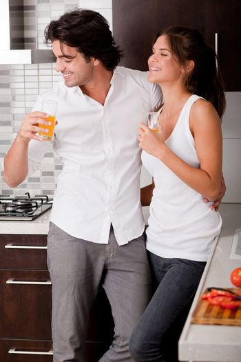 Young couple  chatting while thier drink in the kitchen