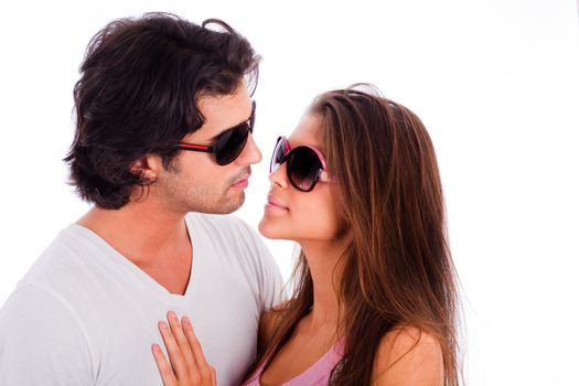 portrait of young couple with sunglasses on isolated white background