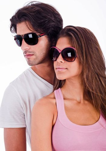 young couple looking right side view with sunglasses