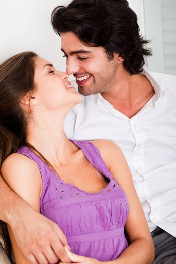 portrait of romantic young couple kissing eachother in causel wear