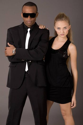 young attractive women and handsome young african man on a grey background