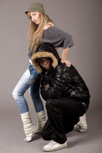 Cute still of a black man and caucasian women on grey background