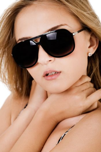 Fashion shot of a beautiful women with sunglasses on a white background