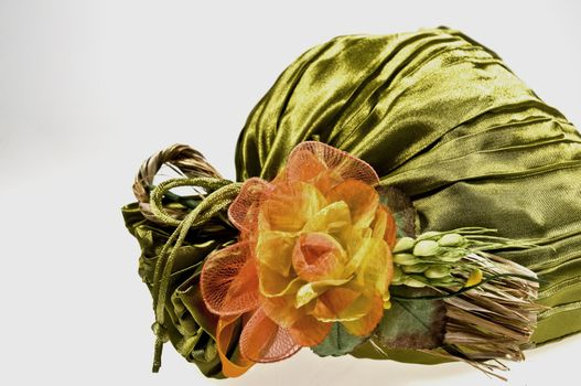 Gift package in green cloth with orange flowers